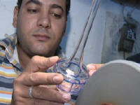 Blown glass being etched in Cairo Egypt  From Cairo with Love