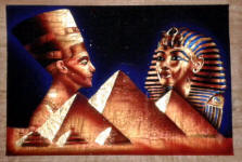 Egyptian Papyrus Painting:  Golden Nefertiti and Mask of King Tut Rising over the Pyramids